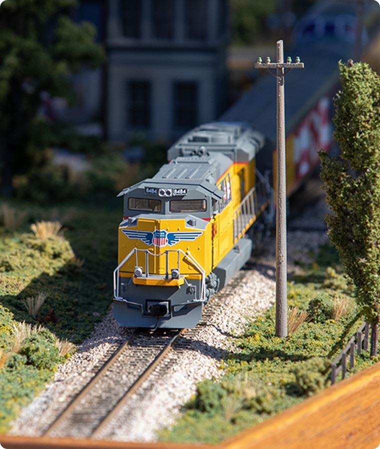 Model train on railroad tracks