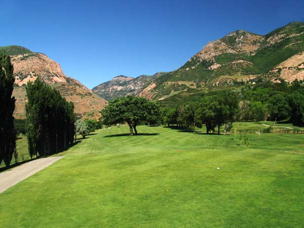 El Monte Golf Course with trees and mountains